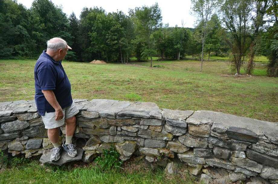 Hour Photo/Alex von Kleydorff. Bob Russell spots a deer on the Keiser Property in Wilton