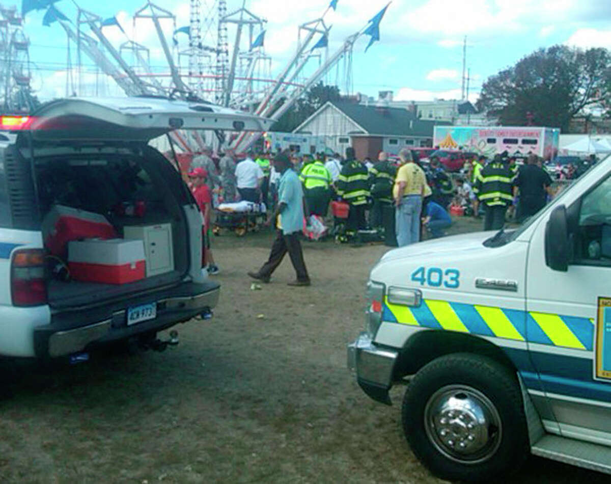CORRECTS SOURCE TO THE CONNECTICUT POST -An amusement park ride malfunctioned Sunday Sept. 8, 2013 at the Norwalk Oyster Festival. Thirteen children were injured when a festival attraction that swings riders into the air lost power at a community fair in Connecticut but none of the injuries appeared to be life-threatening, authorities said. Most of the children suffered minor injuries and were treated at the Oyster Festival in Norwalk, police said. Norwalk Police Chief Thomas Kulhawik said there were initial reports of serious injuries but preliminary indications are that the injuries were not as severe as first feared. (AP Photo/ The Connecticut Post, David Wells)
