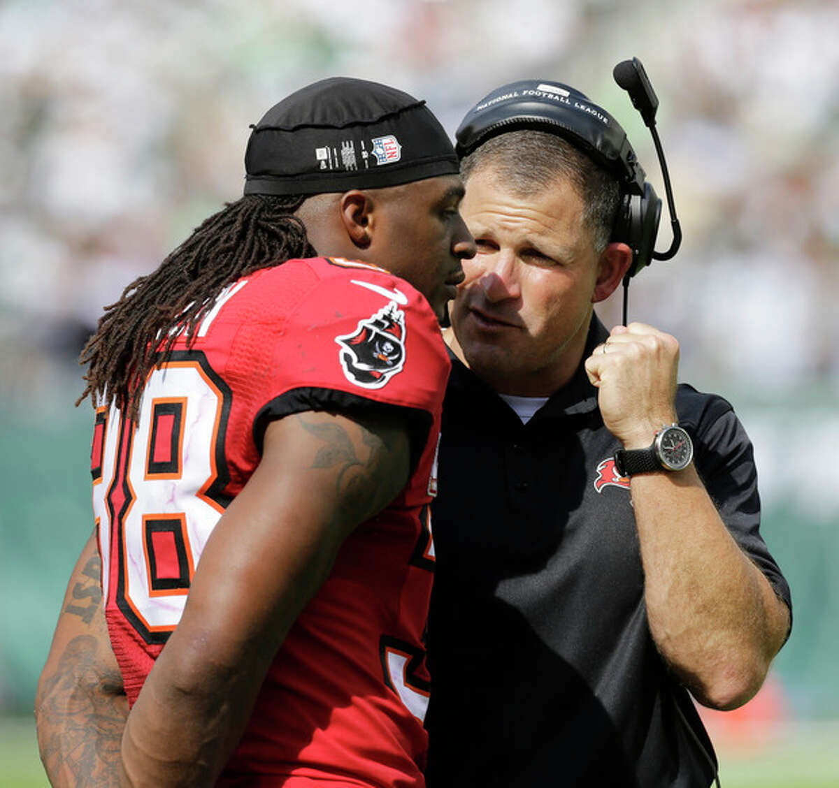 Tampa Bay Buccaneers coach Greg Schiano, right, talks to free safety Dashon Goldson in the second half of an NFL football game against the New York Jets, Sunday, Sept. 8, 2013, in East Rutherford, N.J. (AP Photo/Mel Evans)
