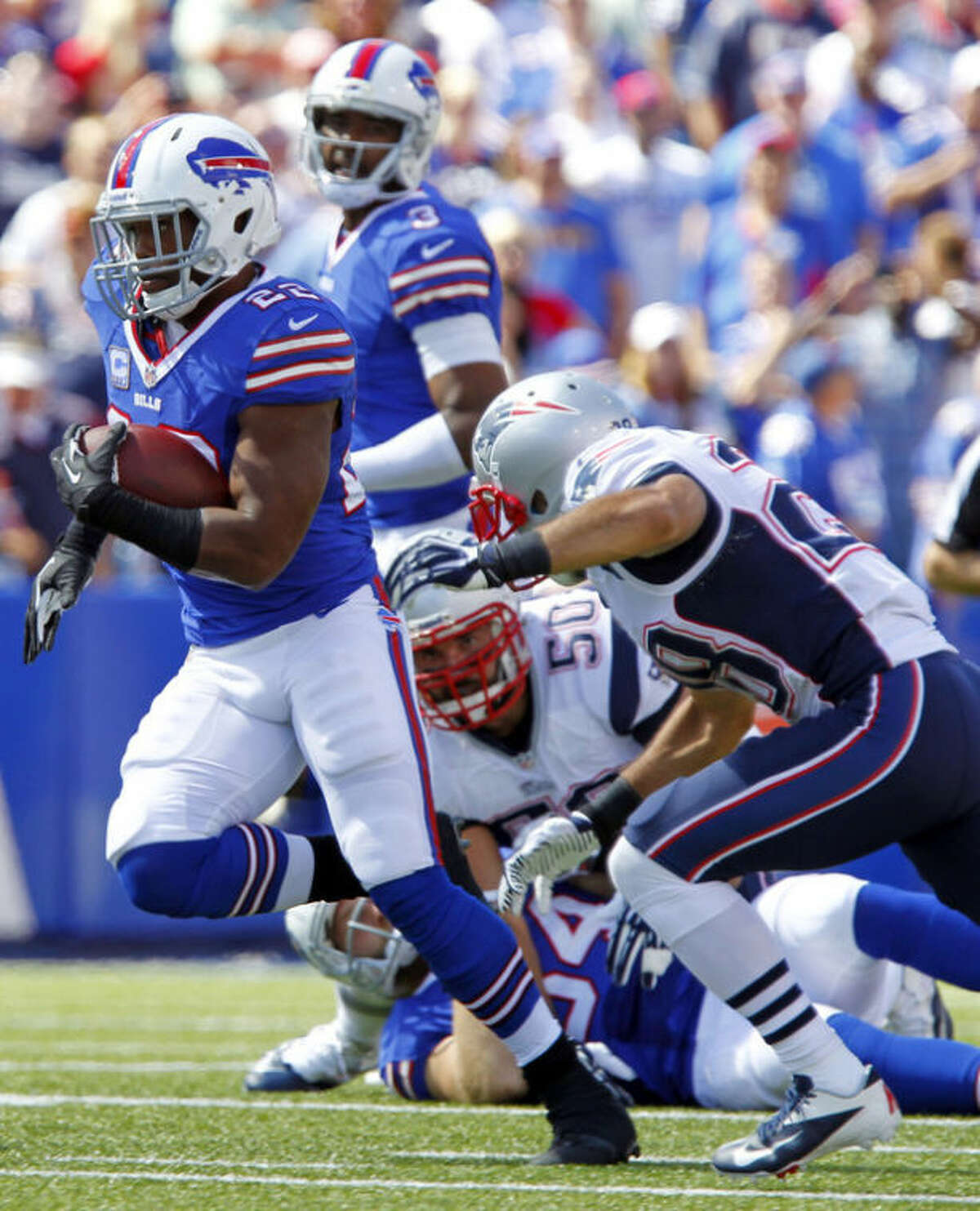 Buffalo Bills running back Fred Jackson (22) gets past New England Patriots' Steve Gregory (28) during the first half of an NFL football game on Sunday, Sept. 8, 2013, in Orchard Park. (AP Photo/Bill Wippert)