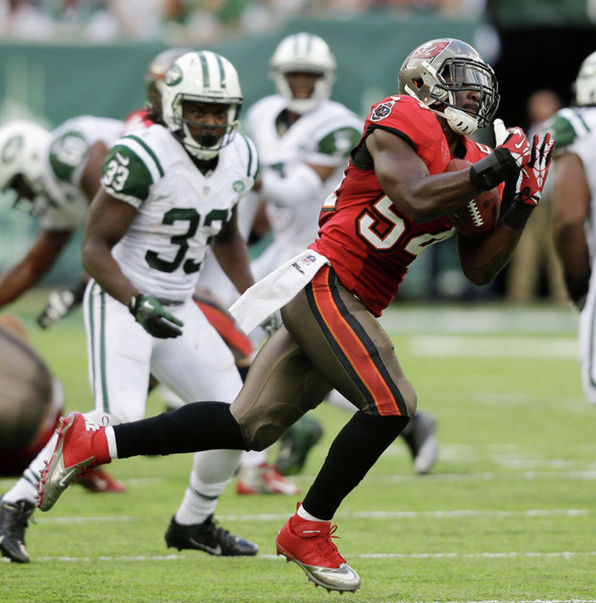 Tampa Bay Buccaneers outside linebacker Lavonte David (54) makes an interception on a pass by New York Jets quarterback Geno Smith in the first half of an NFL football game, Sunday, Sept. 8, 2013, in East Rutherford, N.J. (AP Photo/Mel Evans)