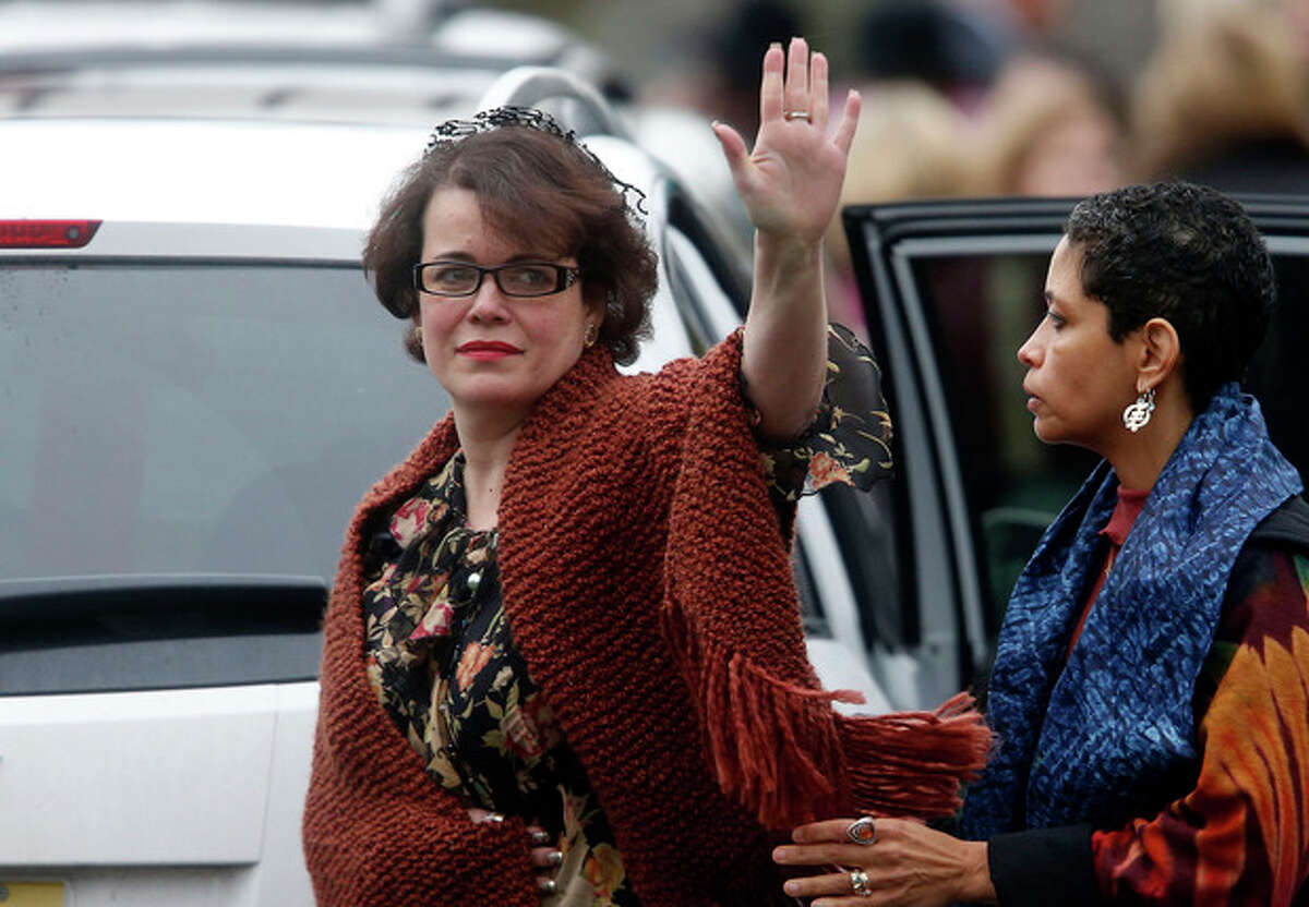 Veronika Pozner waves to the assembled press as she leaves after a funeral service for her son, 6-year-old Noah Pozner, Monday, Dec. 17, 2012, in Fairfield, Conn. Pozner was killed when Adam Lanza walked into Sandy Hook Elementary School in Newtown, Conn., Friday and opened fire, killing 26 people, including 20 children. (AP Photo/Jason DeCrow)