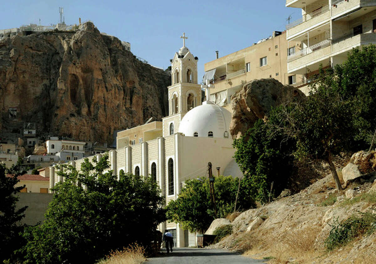 This Saturday, Sept. 7, 2013 photo released by the Syrian official news agency SANA, shows a church in Maaloula village, northeast of the capital Damascus, Syria. Rebels including al-Qaida-linked fighters gained control of Maaloula, Syrian activists said Sunday. Government media provided a dramatically different account of the battle suggesting regime forces were winning. It was impossible to independently verify the reports from Maaloula, a scenic mountain community known for being one of the few places in the world where residents still speak the ancient Middle Eastern language of Aramaic. (AP Photo/SANA)