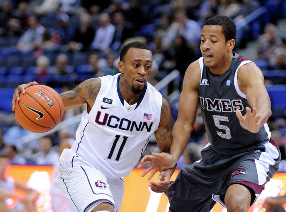 Connecticut's Ryan Boatright, left, drives past Maryland Eastern Shore's Louis Bell during the first half of an NCAA college basketball game in Hartford, Conn., Monday, Dec. 17, 2012. (AP Photo/Fred Beckham)