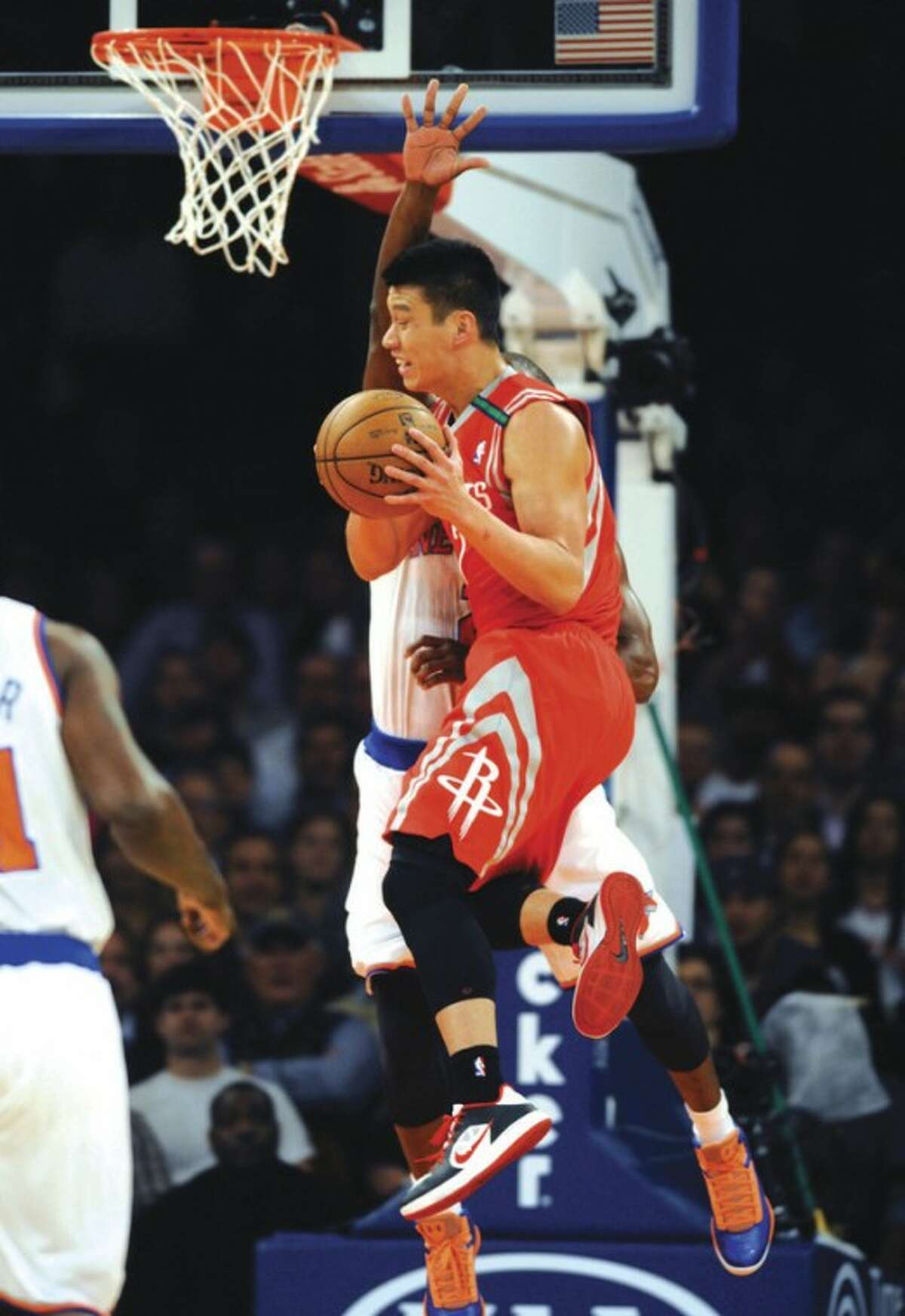 AP photo Houston Rockets' Jeremy Lin, foreground, is defended by New York Knicks' Raymond Felton Monday in his return to Madison Square Garden.