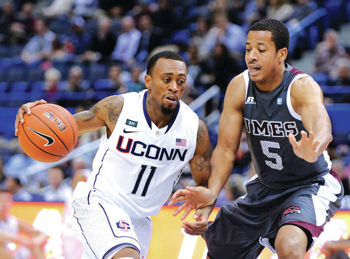 AP photo UConn's Ryan Boatright, left, drives past Maryland Eastern Shore's Louis Bell during the first half of Monday night's game at the XL Center in Hartford. Playing for the first time in 10 days, the Huskies brushed aside winless Maryland Eastern Shore.