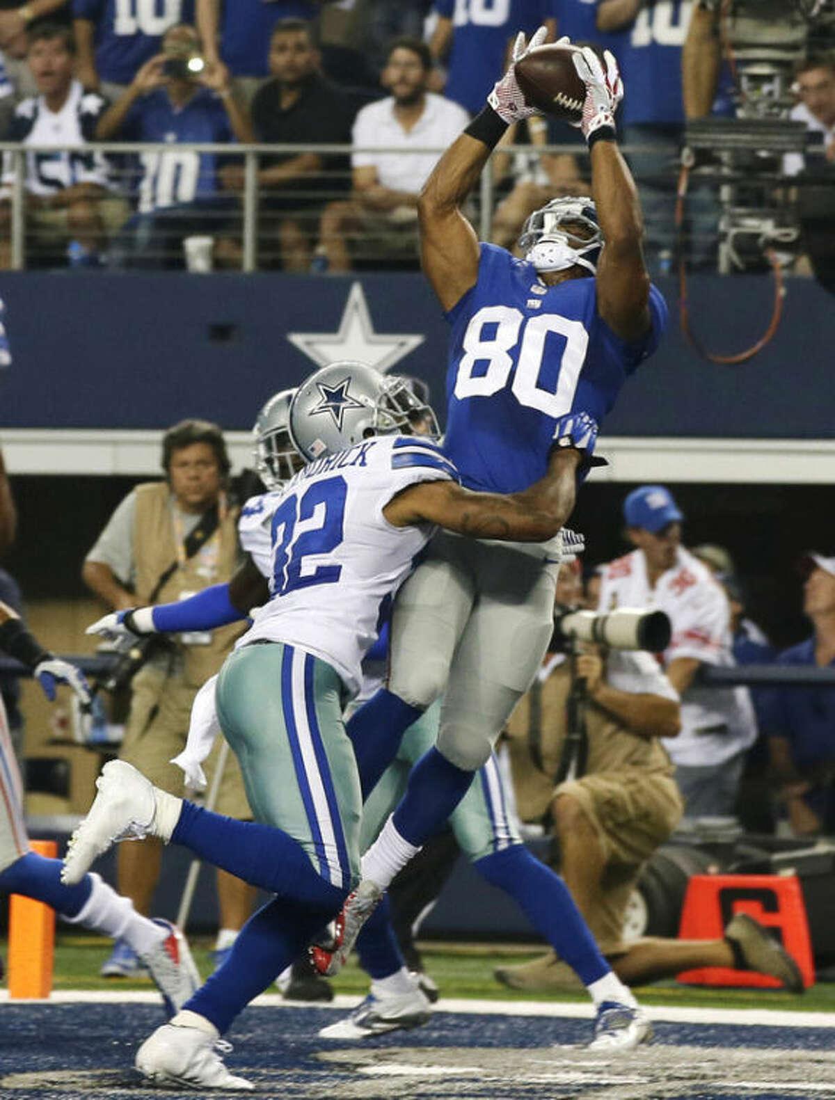 New York Giants wide receiver Victor Cruz (80) makes a 10-yard touchdown reception as Dallas Cowboys cornerback Orlando Scandrick (32) defends during the second half of an NFL football game, Sunday, Sept. 8, 2013, in Arlington, Texas. (AP Photo/Tony Gutierrez)