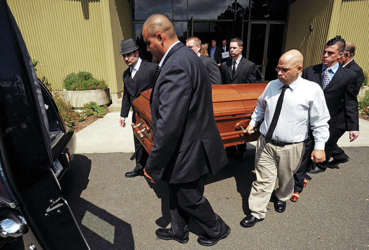 Pallbearers for Neil Godleski remove his casket from St. Phillips Church in Norwalk following Godleski's funeral Thursday. The 29 year old Norwalk native was shot to death in Washington D.C. Sunday during an apparent robbery attempt. Hour photo / Erik Trautmann