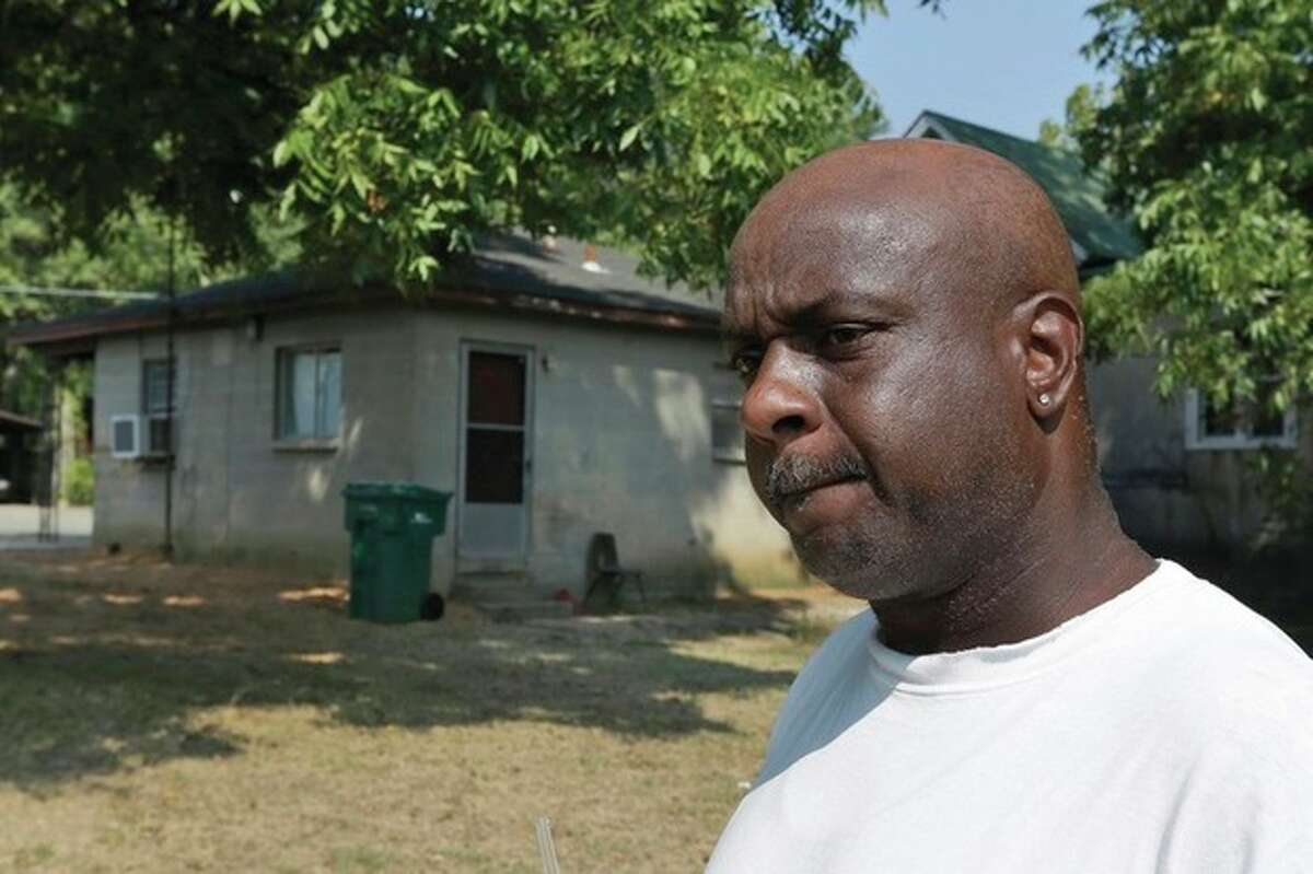 AP photo / Danny Johnston Dwayne Grant, former neighbor of 107-year-old Monroe Isadore, is interviewed Monday near Isadore's former residence in Pine Bluff, Ark. Police halted a standoff at another address Saturday when they shot Isadore who they say opened fire at them.