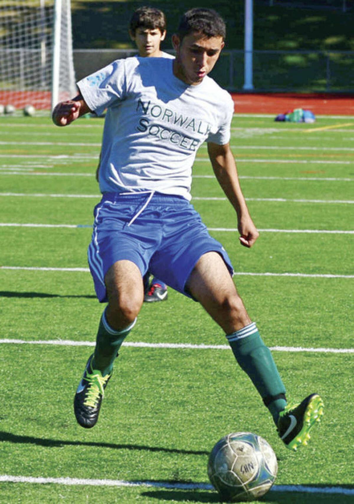 Hour photo/John Nash Norwalk High School boys soccer player Rene Jimenez dribbles the ball on the Testa Field turf at a preseason practice.