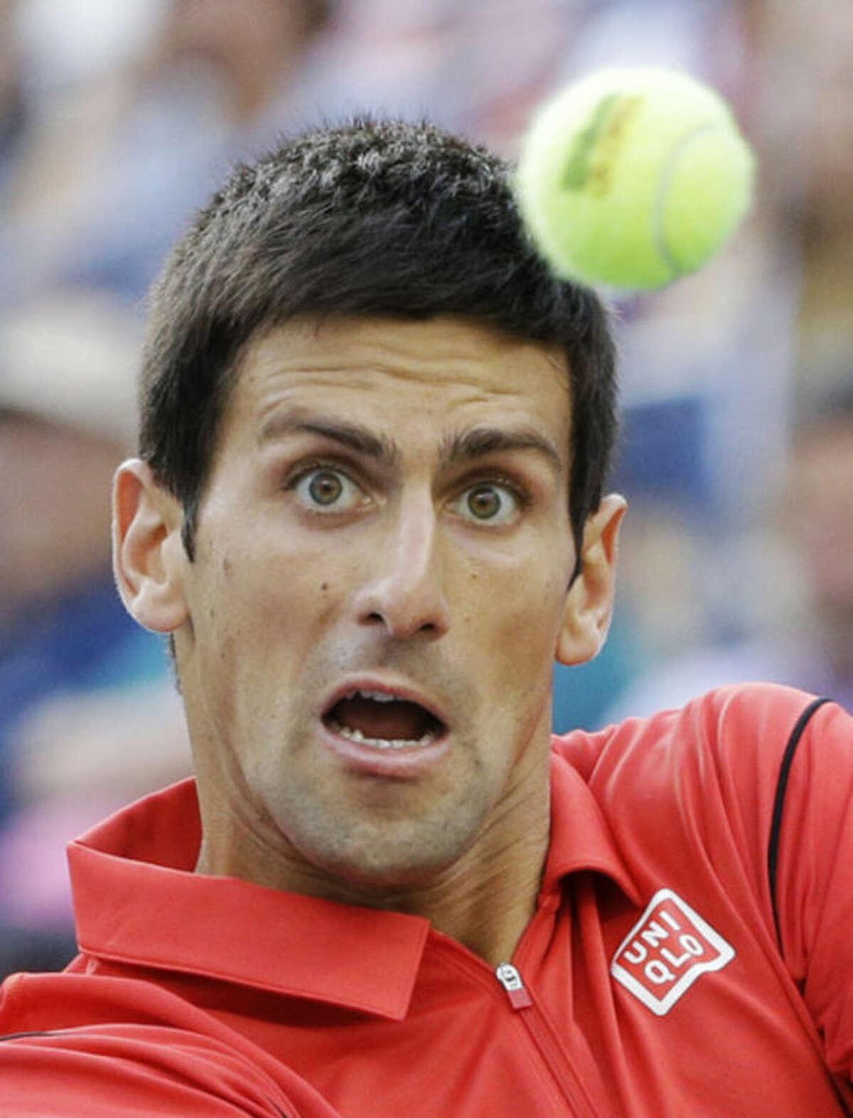 Novak Djokovic, of Serbia, returns a shot to Rafael Nadal, of Spain, during the men's singles final of the 2013 U.S. Open tennis tournament, Monday, Sept. 9, 2013, in New York. (AP Photo/David Goldman)