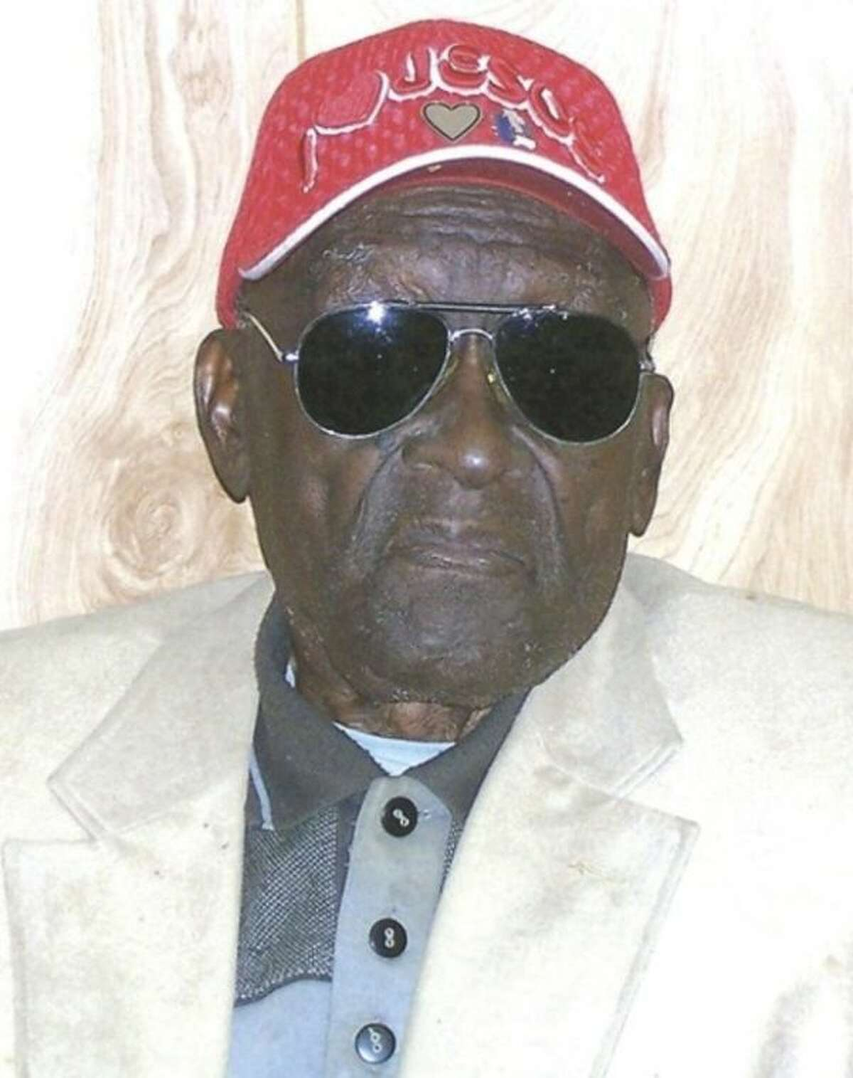 In this 2011 photo provided by the Pine Bluff Commercial, Monroe Isadore poses for photos on his 105th birthday in Pine Bluff, Ark. Authorities in Arkansas halted a standoff on Saturday, Sept. 7, 2013, when they shot and killed Isadore, 107, who opened fire at them. (AP Photo/Courtesy Pine Bluff Commercial)