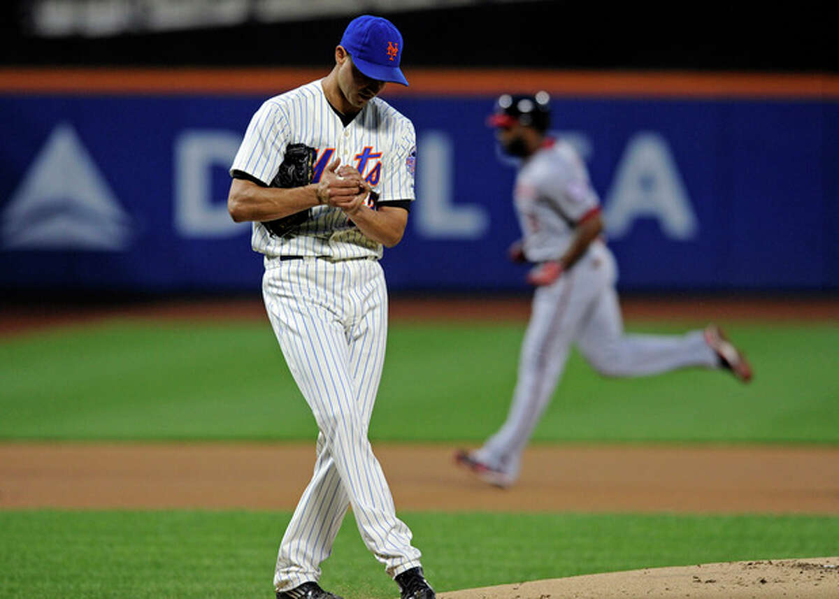 New York Mets pitcher Carlos Torres reacts as Washington Nationals' Denard Span, right, rounds the bases with a home run during the first inning of a baseball game, Monday, Sept. 9, 2013, in New York. (AP Photo/Bill Kostroun)