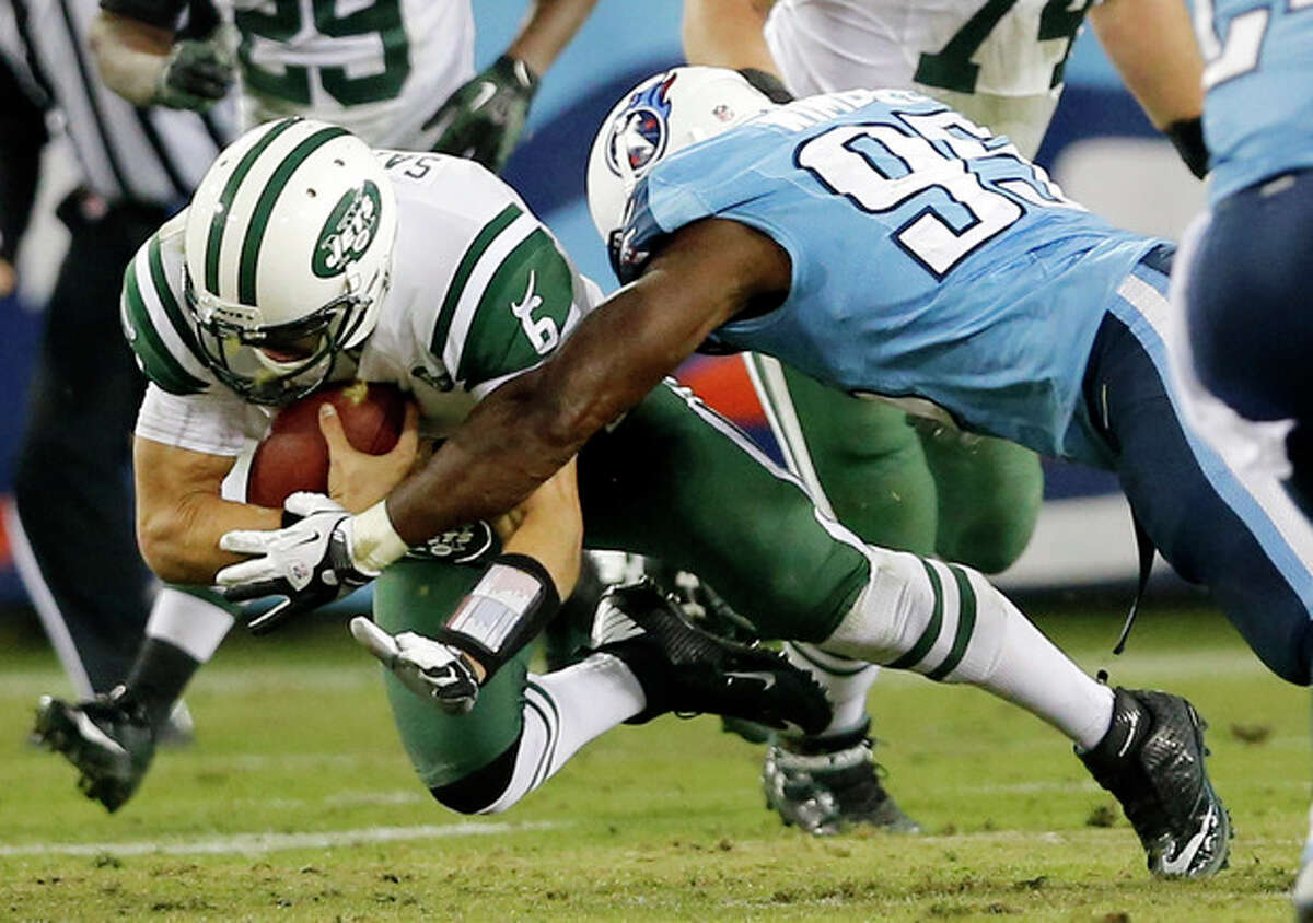 New York Jets quarterback Mark Sanchez (6) is brought down by Tennessee Titans defensive end Kamerion Wimbley (95) in the second quarter of an NFL football game, Monday, Dec. 17, 2012, in Nashville, Tenn. The Titans won 14-10. (AP Photo/Joe Howell)