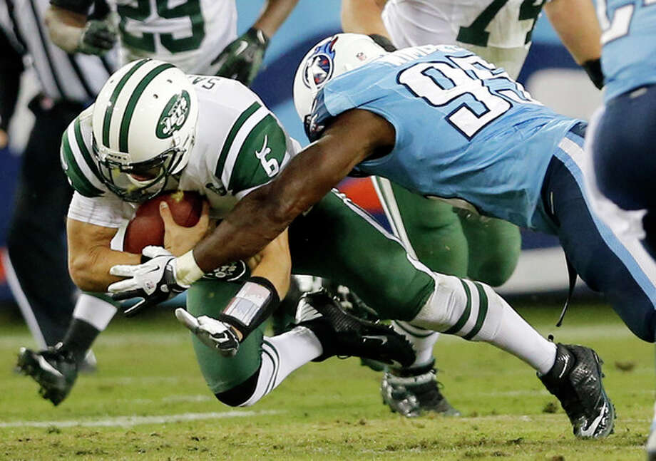 New York Jets quarterback Mark Sanchez (6) is brought down by Tennessee Titans defensive end Kamerion Wimbley (95) in the second quarter of an NFL football game, Monday, Dec. 17, 2012, in Nashville, Tenn. The Titans won 14-10. (AP Photo/Joe Howell) / FR14085 AP