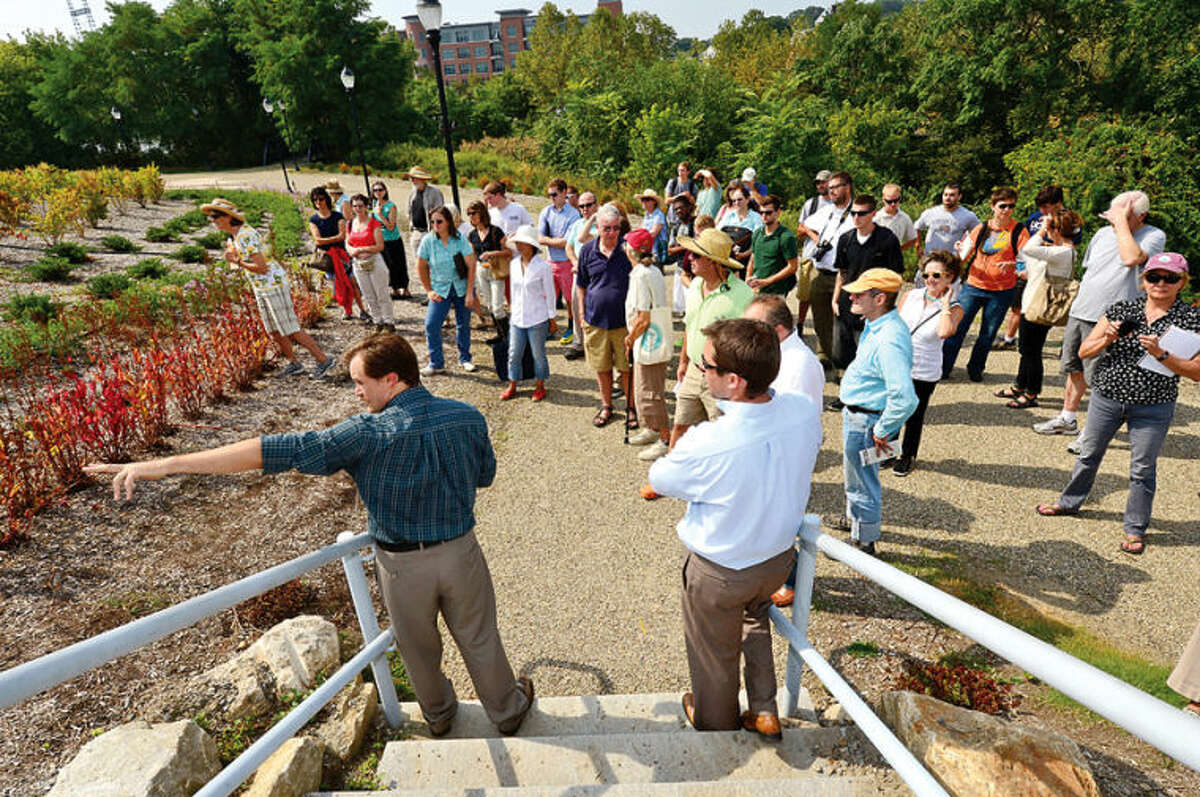 Casey Lee and Luke McCoy of BSC landscaping architecture lead a tour of Norwalk's Oyster Shell Park Thursday for The Ecological Landscaping Association. Oyster Shell Park is part of the State of Connecticut Heritage Park System and is one of the Pilot Projects for the SITES Sustainable Sites Initiative, a partnership of the American Society of Landscape Architects, the Lady Bird Johnson Wildflower Center at the University of Texas and the United State Botanical Garden. Hour photo / Erik Trautmann