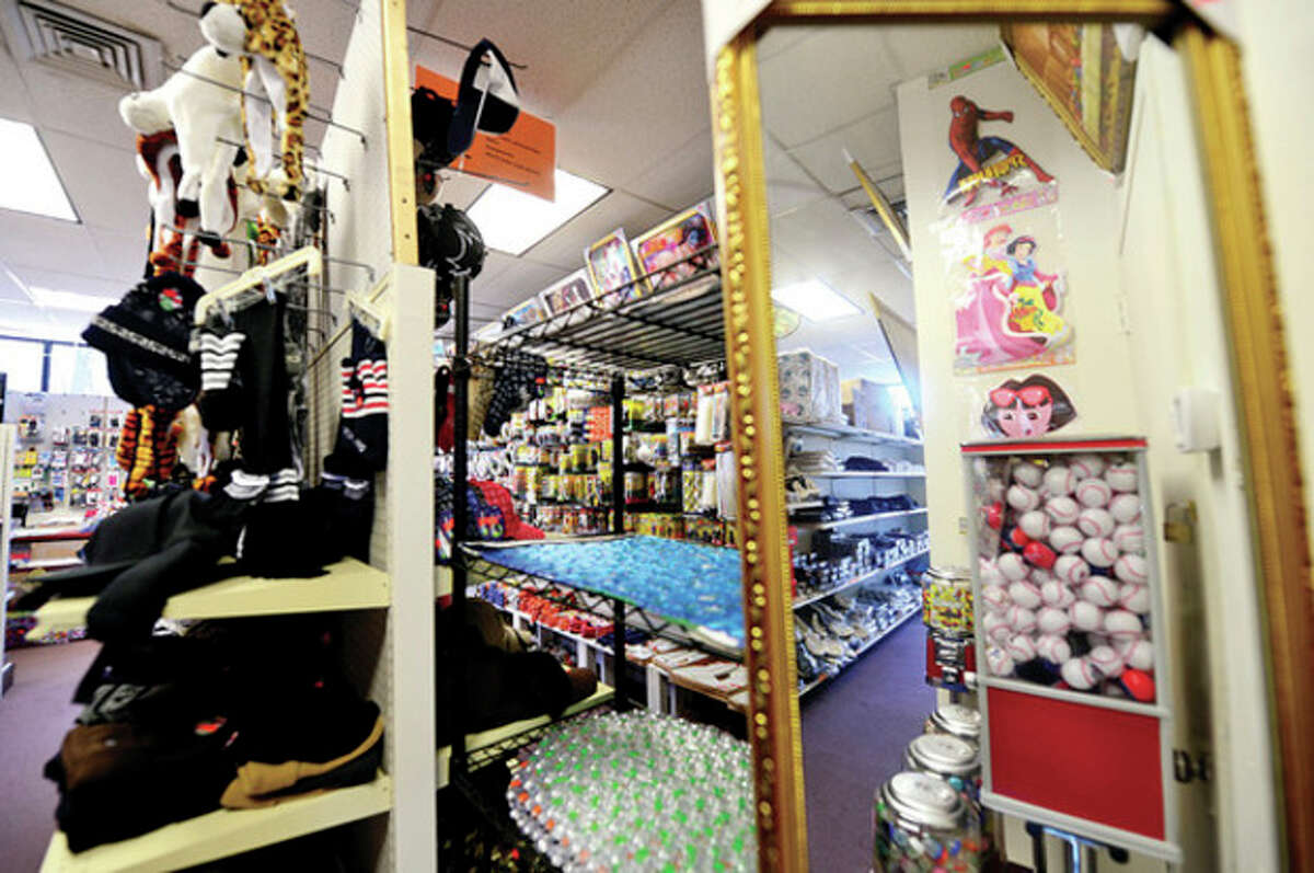 The Norwalk Dollar & Gift store moved to North Main St from Wall St. Hour photo / Erik Trautmann