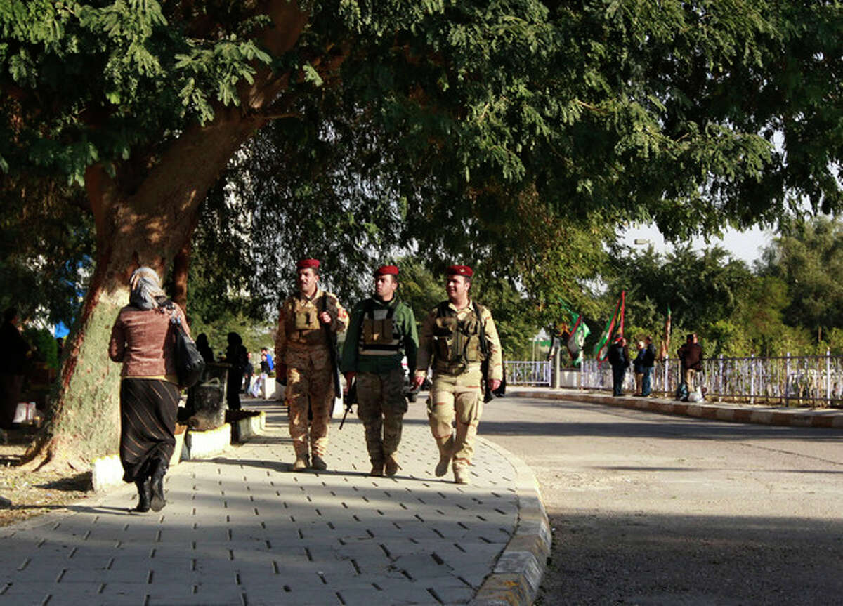 Iraqi Presidential guards walk outside the hospital where Iraqi president Jalal Talabani is receiving treatment at the Medical City in Baghdad, Iraq, Tuesday, Dec. 18, 2012. Iraqi President Jalal Talabani has been hospitalized in Baghdad after suffering a stroke and is in stable condition, a spokesman for the prime minister said Tuesday. (AP Photo/ Hadi Mizban)