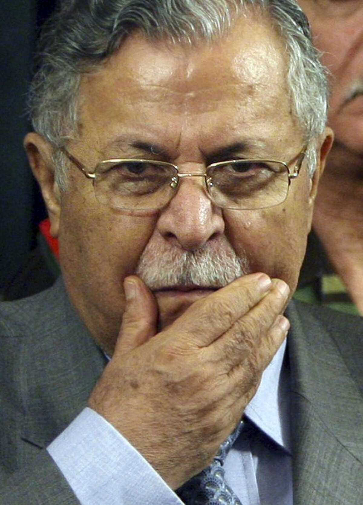 FILE - In this Aug 2, 2006 file photo, Iraq's President Jalal Talabani pauses after announcing new security plans in Baghdad, Iraq. The office of Iraqi President Jalal Talabani said Tuesday he has been admitted to the hospital for treatment of an unspecified health problem. (AP Photo/Khalid Mohammed, File)