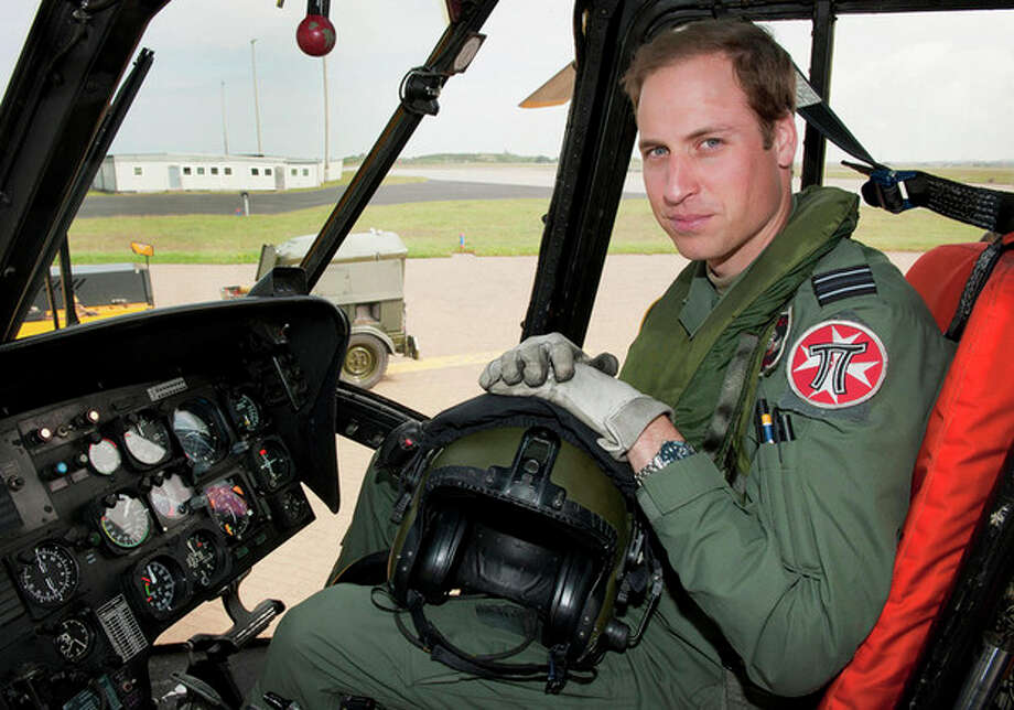 AP Photo/ SAC Faye Storer, MOD, FileIn this Friday, June 1, 2012 file photo released by Britain's Ministry of Defence , Britain's Prince William sits in the cockpit of a helicopter at RAF Valley in Anglesey Wales. Prince William has finished his tour of duty as a Royal Air Force search-and-rescue helicopter pilot and has left operational service with the British military to focus on royal duties and charity work, royal officials said Thursday, Sept 12. / MOD