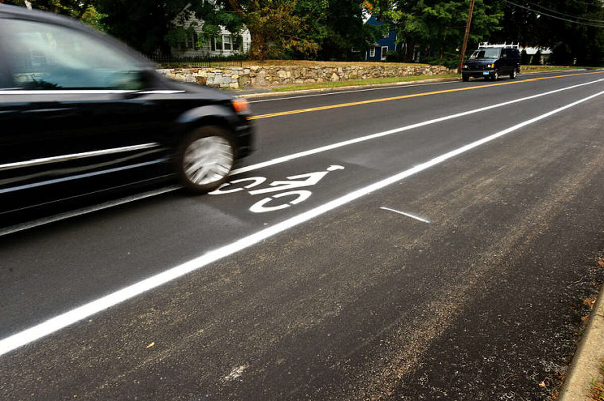 New bike lanes on Strawberry Hill Ave have perplexed motorists and bicyclists alike. Hour photo / Erik Trautmann