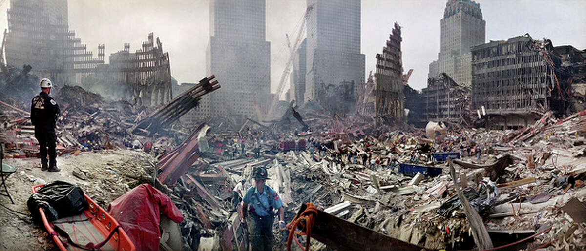 FILE - In this Monday, Sept. 24, 2001 file photo, rescue workers examine the site of the Sept. 11, 2001 World Trade Center terrorist attacks in New York. The most comprehensive study of potential World Trade Center-related cancers raises more questions than it answers and won't end a debate over whether the attacks were really a cause. (AP Photo/Ted S. Warren, Pool, File)