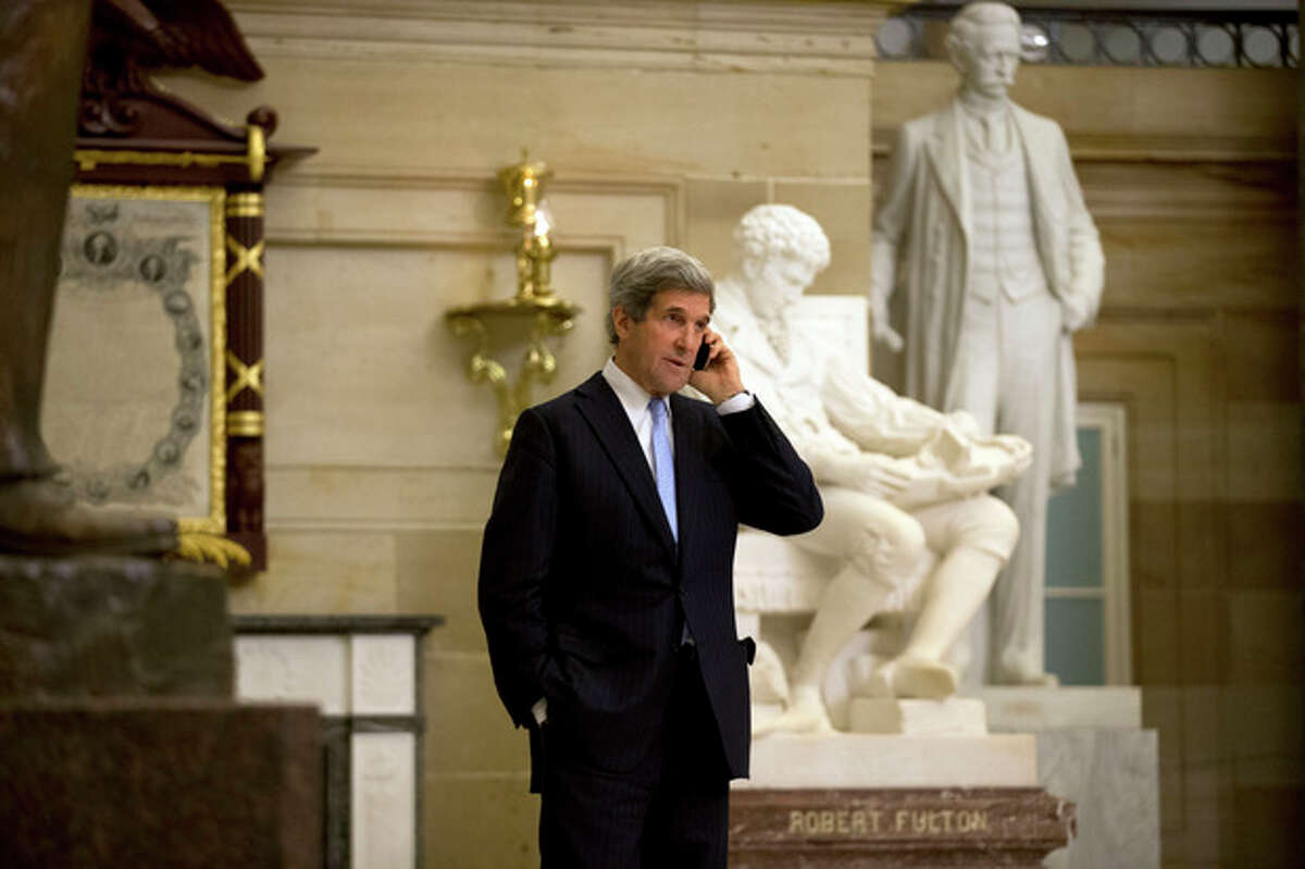 Sen. John Kerry, D-Mass., talks on a phone in Statuary Hall on Capitol Hill, Thursday, Dec. 20, 2012 in Washington. President Obama will nominate Sen. John Kerry as his next secretary of state, a senior administration official says, making the first move in a sweeping overhaul of his national security team heading into a second term. (AP Photo/Alex Brandon)