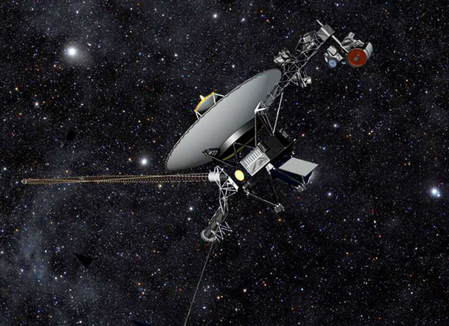This artist rendering released by NASA shows NASA's Voyager 1 spacecraft barreling through space. The space agency announced Thursday, Sept. 12, 2013 that Voyager 1 has become the first spacecraft to enter interstellar space, or the space between stars, more than three decades after launching from Earth. (AP Photo/NASA) / NASA