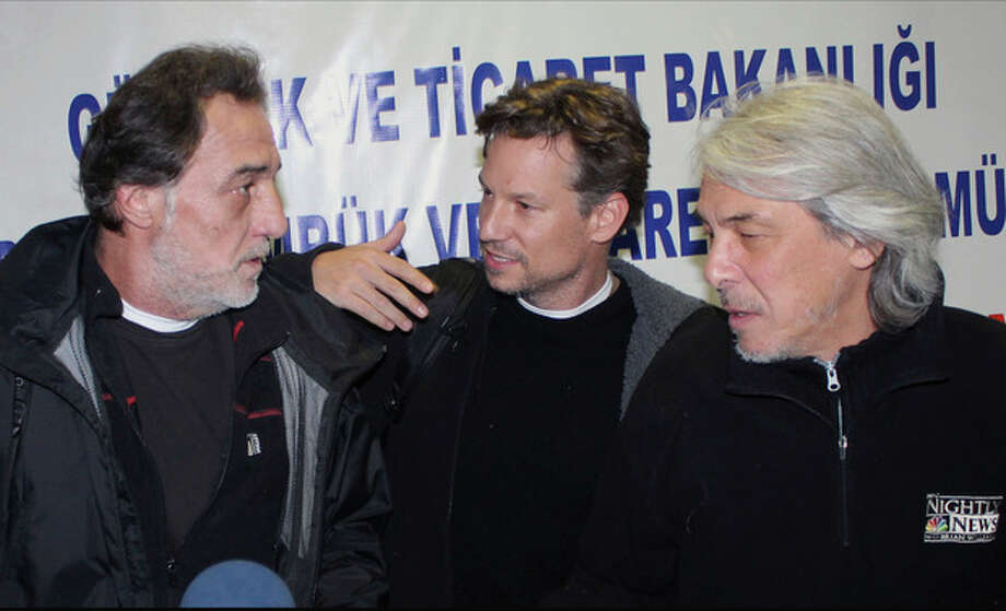 NBC chief foreign correspondent Richard Engel, center, NBC Turkey reporter Aziz Akyavas, left, and an unidentfied NBC crew member speak during a news conference in Reyhanli, Turkey, Tuesday, Dec. 18. 2012. More than a dozen pro-regime gunmen kidnapped and held NBC's chief foreign correspondent Richard Engel and several colleagues for five days inside Syria, threatening them with mock executions and blindfolding them before the team finally escaped unharmed during a firefight between their captors and rebels, Engel said Tuesday. (AP Photo/Anatolia) TURKEY OUT, ONLINE OUT / Anatolia