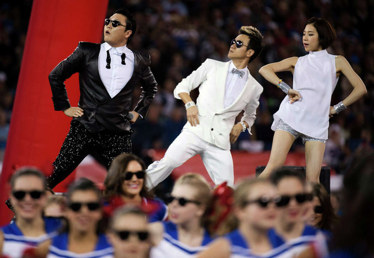 FILE - In this Sunday, Dec. 16, 2012 file photo, South Korean entertainer PSY, left, performs the song