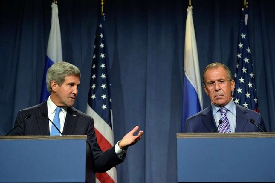 U.S. Secretary of State John Kerry speaks next to Russian Foreign Minister Sergey Lavrov, right, during a press conference before their meeting to discuss the ongoing crisis in Syria, in Geneva, Switzerland, Thursday Sept. 12, 2013. Secretary of State John Kerry and his team have opened two days of meetings with their Russian counterparts in Geneva. Kerry is hoping to come away with the outlines of a plan for securing and destroying vast stockpiles of Syrian chemical weapons. (AP Photo/Keystone, Martial Trezzini) / Keystone