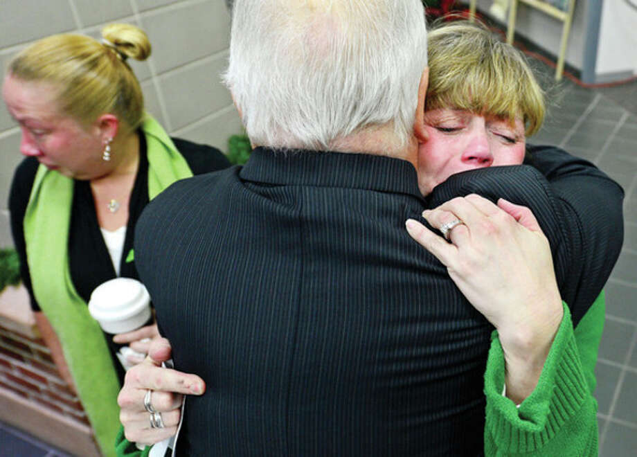 Local officials including staffer Erin Halsey grieve during a brief ceremony with a moment of silence in honoring the victims of the Sandy Hook shooting which claimed the livees of 26 people including 20 children.Hour photo / Erik Trautmann / (C)2012, The Hour Newspapers, all rights reserved