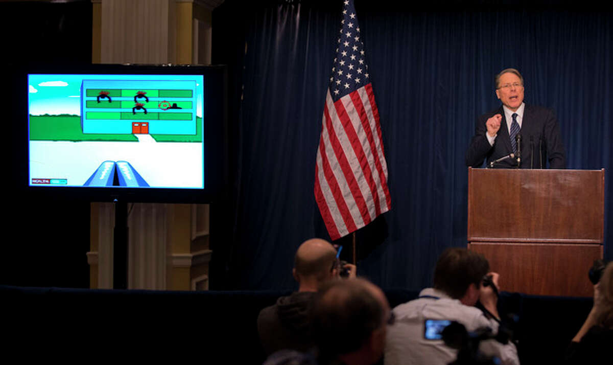 The National Rifle Association executive vice president Wayne LaPierre gestures as he speaks about the violent online video game