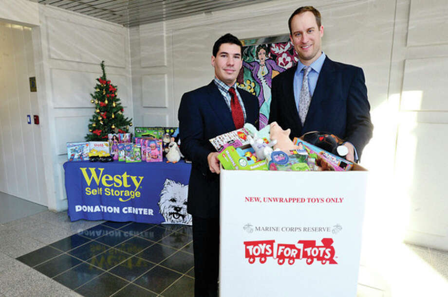 Associate Jon Crudele and Director Dorian Melkonian at The Westy's Self Storage in Wilton are hosting drop off for the local Toys for Tots program.Hour photo / Erik Trautmann / (C)2012, The Hour Newspapers, all rights reserved