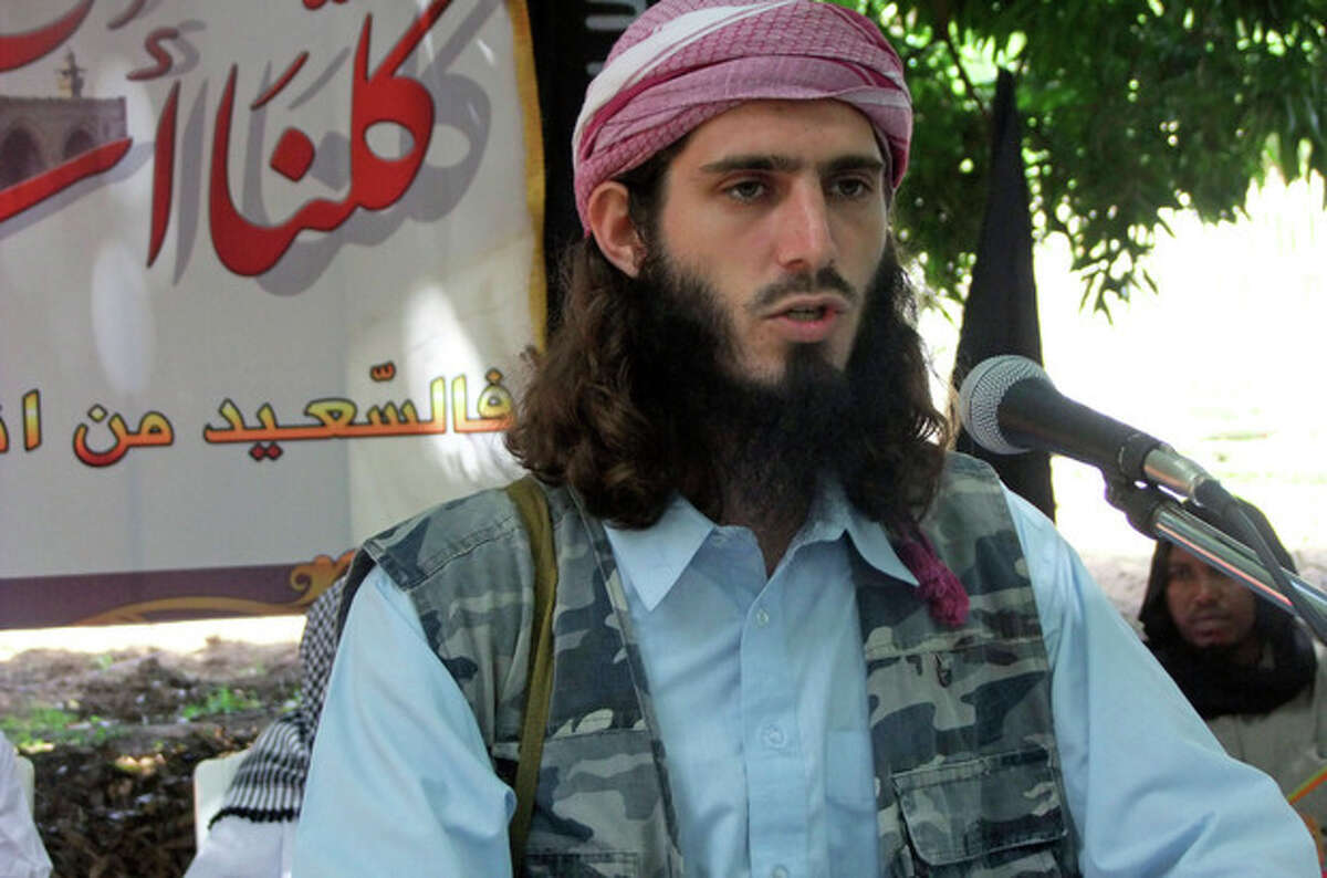 FILE - In this Wednesday, May 11, 2011 file photo, American-born Islamist militant Omar Hammami addresses a press conference of the militant group al-Shabab at a farm in southern Mogadishu's Afgoye district in Somalia. Hammami, a jihadi from Alabama whose nom de guerre is Abu Mansoor Al-Amriki, or