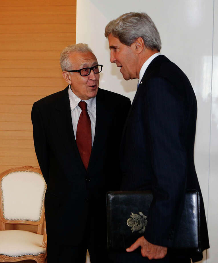 U.S. Secretary of State John Kerry, right, meets with the U.N. Special Representative for Syria Lakhdar Brahimi in Geneva, Switzerland Thursday Sept. 12, 2013. Kerry flew into Geneva on Thursday to hear Russia's plans to disarm Syria of its chemical weapons and avert U.S.-led military strikes. (AP Photo/Larry Downing, Pool) / Pool Reuters
