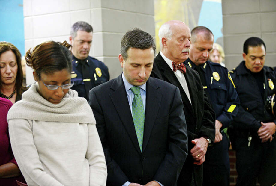 Local officials hold a brief ceremony with a moment of silence in honoring the victims of the Sandy Hook shooting which claimed the livees of 26 people including 20 children. Hour photo / Erik Trautmann / (C)2012, The Hour Newspapers, all rights reserved