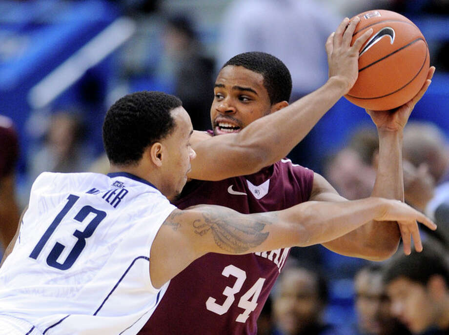 Fordham's Jermaine Myers, right, is guarded by Connecticut's Shabazz Napier during the first half of an NCAA college basketball game in Hartford, Conn., Friday, Dec. 21, 2012. (AP Photo/Fred Beckham) / FR153656 AP