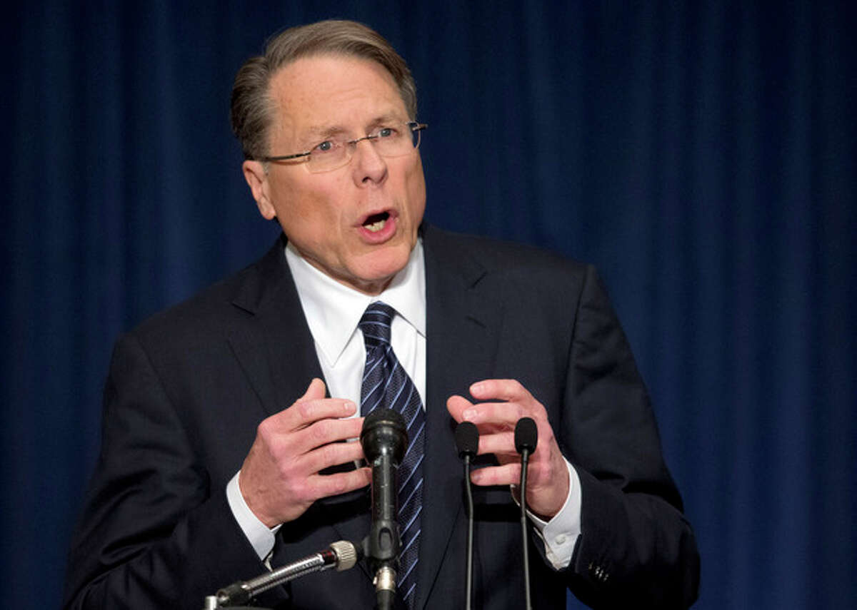 The National Rifle Association executive vice president Wayne LaPierre, gestures during a news conference in response to the Connecticut school shooting on Friday, Dec. 21, 2012 in Washington. The nation's largest gun-rights lobby is calling for armed police officers to be posted in every American school to stop the next killer