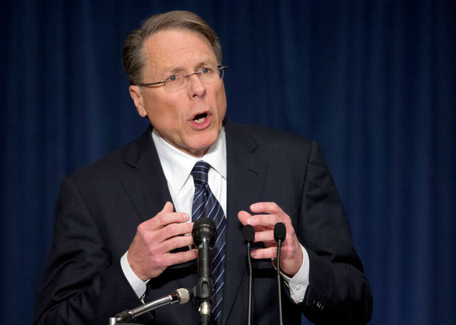 "The National Rifle Association executive vice president Wayne LaPierre, gestures during a news conference in response to the Connecticut school shooting on Friday, Dec. 21, 2012 in Washington. The nation's largest gun-rights lobby is calling for armed police officers to be posted in every American school to stop the next killer ""waiting in the wings."" (AP Photo/ Evan Vucci) / AP"