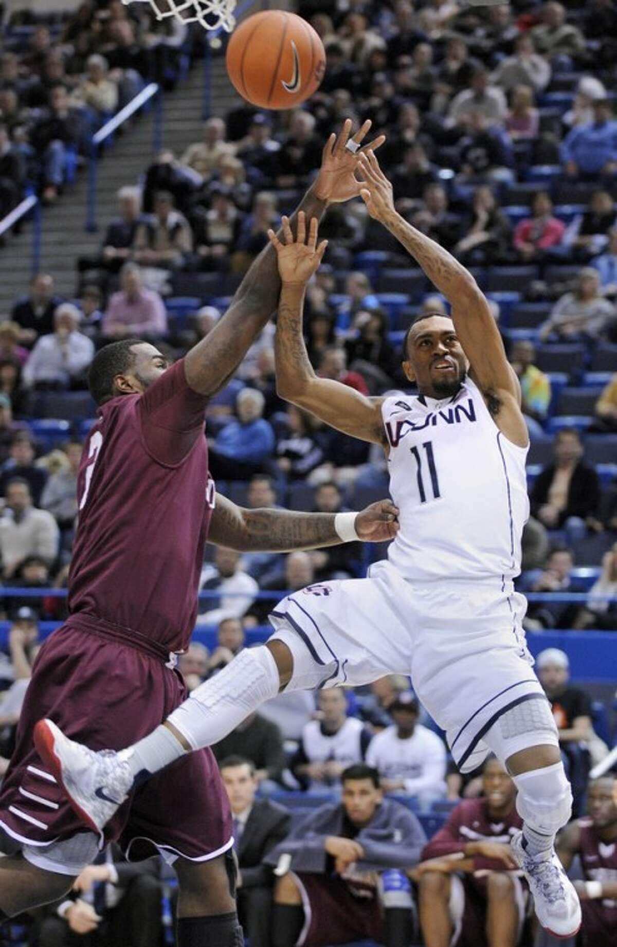 Connecticut's Ryan Boatright, right, is fouled by Fordham's Travion Leonard during the first half of an NCAA college basketball game in Hartford, Conn., Friday, Dec. 21, 2012. (AP Photo/Fred Beckham)