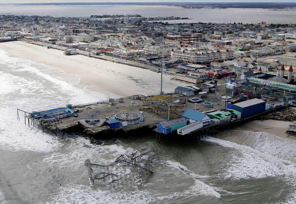 FILE - This Oct. 31, 2012 file aerial photo shows the damage to an amusement park in Seaside Heights, N.J., after Superstorm Sandy. A massive fire raging for hours Thursday, Sept. 12, 2013, burned several blocks of a boardwalk and businesses in Seaside Heights, N.J. (AP Photo/Mike Groll, File)