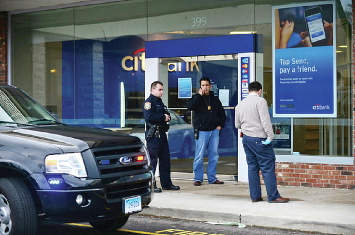 Westport and Norwalk police investigate the apparent hold up at the Citibank branch at 399 Westport Ave Friday afternoon. Hour photo / Erik Trautmann