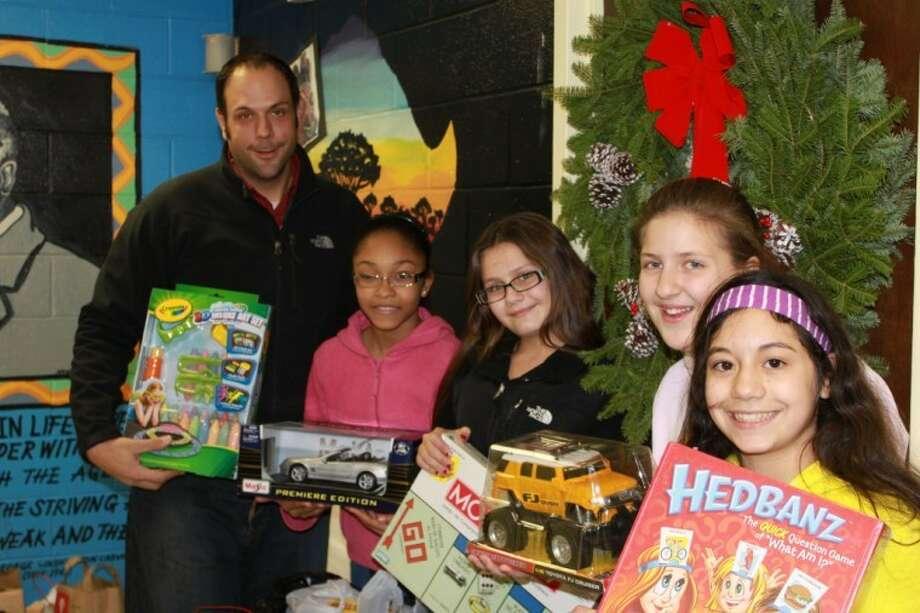 Mr. Joseph Giandurco Ponus P.R.I.D.E. Program Director, students Angel Reyes, Casey Keenan, Lilly King and Jasmin Cruz