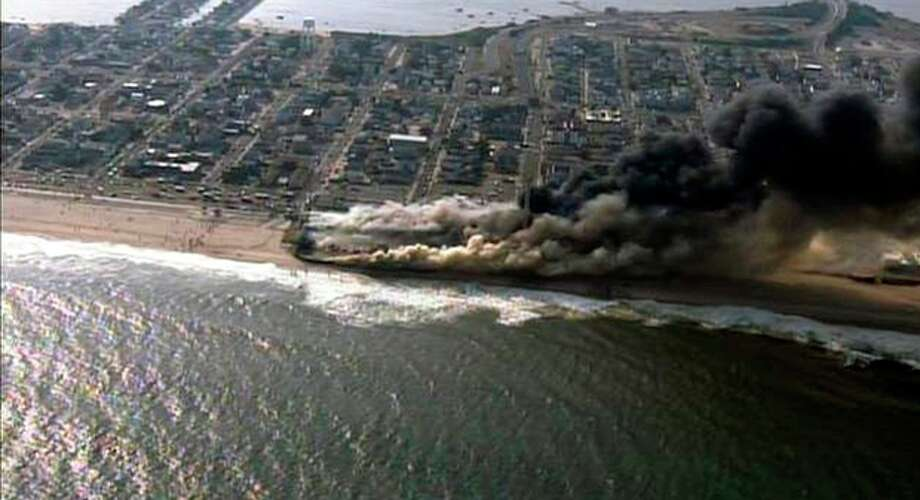 CORRECTS LOCATION TO SEASIDE HEIGHTS INSTEAD OF SEASIDE PARK - This frame grab from video provided by Fox 29 shows a raging fire in Seaside Heights, N.J. on Thursday, Sept. 12, 2013. The fire apparently started in an ice cream shop and spread several blocks down the New Jersey shore boardwalk that was damaged in Superstorm Sandy (AP Photo/Fox 29) MANDATORY CREDIT / Fox 29