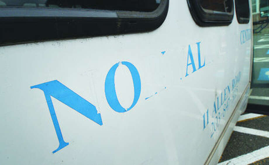 Hour Photo/Alex von Kleydorff. Letters stripped from the side of the Norwalk senior Centers 21 passeneger bus by vandals