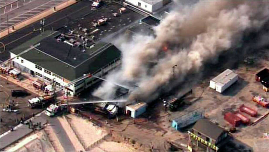 CORRECTS LOCATION TO SEASIDE HEIGHTS INSTEAD OF SEASIDE PARK - In this aerial image taken from video and provided by Fox 29, firefighters battle a raging fire on boardwalk in Seaside Heights, N.J., Thursday, Sept. 12, 2013. The fire apparently started in an ice cream shop then spread several blocks down a New Jersey shore boardwalk that was damaged in Superstorm Sandy and was being repaired. (AP Photo/Fox 29) NO SALES / FOX 29