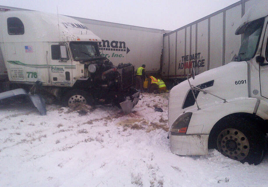This photo provided by the Iowa State Patrol shows the scene of a 25-vehicle pileup that killed two people and injured several others Thursday, Dec. 20, 2012 on Interstate 35 about 60 miles north of Des Moines, Iowa. Authorities say poor visibility caused the accident when drivers were unable to see vehicles that had slowed or stopped, causing a chain reaction of crashes. (AP Photo/Iowa State Patrol) / Iowa State Patrol