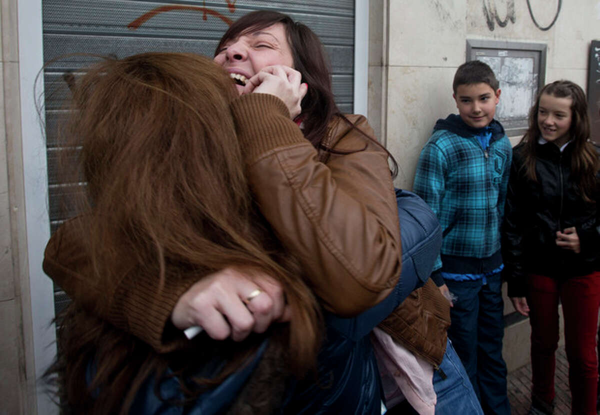 Azahara, right, hugs her mother after winning the main Christmas lottery prize ?