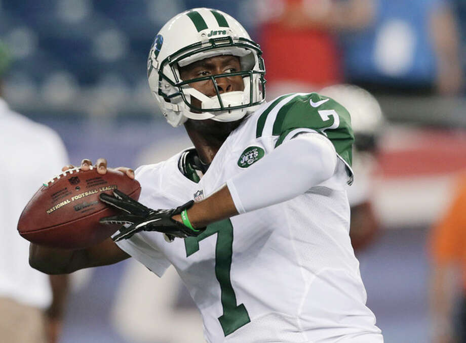 New York Jets quarterback Geno Smith throws a pass as he warms up for the Jets' NFL football game against the New England Patriots on Thursday, Sept. 12, 2013, in Foxborough, Mass. (AP Photo/Charles Krupa) / AP